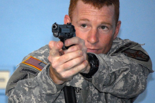 Staff Sgt. Timothy A. McCullough, a Military Policeman at U.S. Army Garrison Brussels, practices his pistol techniques during Active Shooter training on July 26.