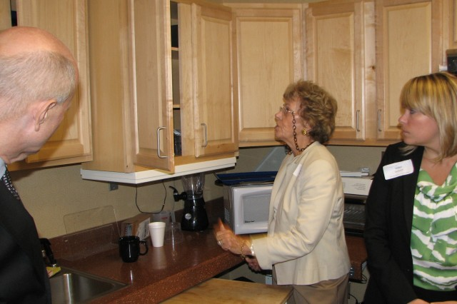 Shepherd shows a kitchen with specially designed shelves and appliances that can raise or lower to help make the room accessible to wheelchair- bound individuals. The center uses the room to allow patients to see what they may need to function normally once they are released