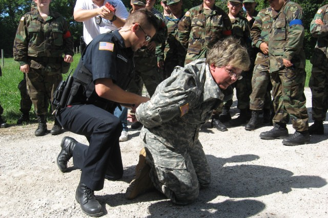 Rock Island Law Enforcement showing all the Military Explorers how to detain and arrest a trouble maker.