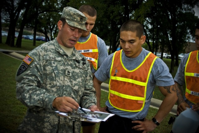 FORT HOOD, Texas- Sgt. 1st Class John Cline (left), in charge of the Ranger Assessment Program (RAP), prepares candidates from the 1st Cavalry Division for a 5 mile run, July 27. All participants must complete this hill infested course in less than 4...