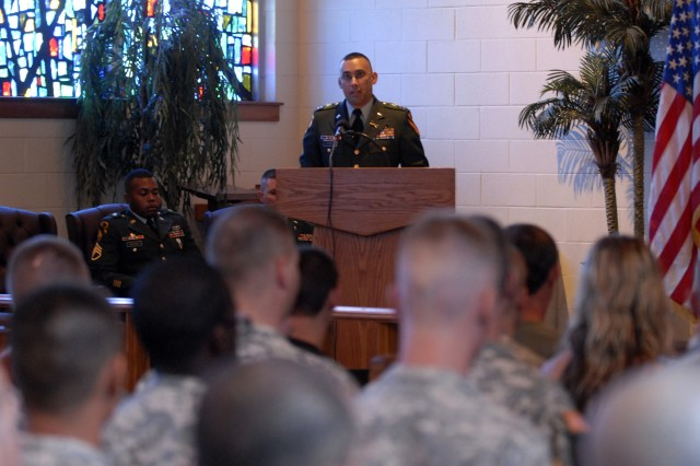 FORT HOOD, Texas - Capt. Ivan Torres, commander for B Troop, 6th Squadron, 9th Cavalry Regiment, 3rd Brigade Combat Team, 1st Cavalry Division, addresses Family members and Soldiers at Fort Hood's 1st Cavalry Division's Memorial Chapel during the memorial service for Pvt. Charles Paul King, July 29.