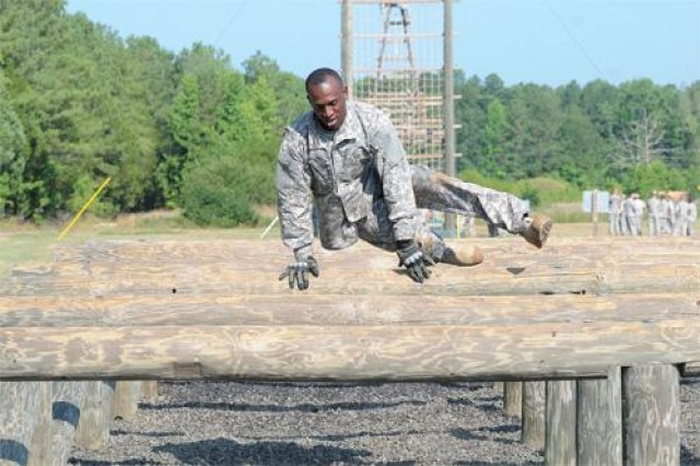 A Soldier from the 49th Quartermaster group negotiates an obstacle as part of a leader training event.  (U.S. Army photo)