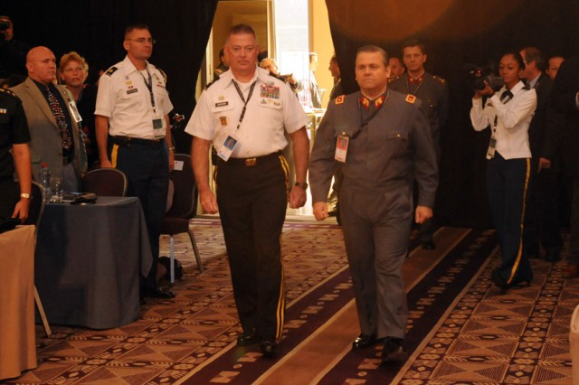 Santiago (Aug. 2, 2010) -- Big. Gen. John Seward, deputy commanding general, U.S. Army Pacific, and Brig. Gen. Alejandro Arancibia, Chilean army international affairs director, enter the grand ballroom of the Grand Hyatt Hotel during the opening ceremony of the Pacific Armies Management Seminar (PAMS) XXXIV in Santiago, Chile on Aug. 2. PAMS is a multinational military seminar that provides a forum for senior-level officers from the Asia Pacific's regional ground forces to exchange views and ideas. The seminar is scheduled Aug. 2-6, 2010.