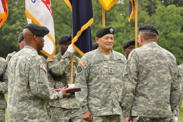 FORT McPHERSON, Ga. (Aug. 2, 2010)- U.S. Army Forces Command (FORSCOM) Commander Gen. James D. Thurman (right) awards FORSCOM's Deputy Command General Lt. Gen. Joseph F. Peterson the Distinguished Service Medal during a retirement ceremony for Peterson here today.