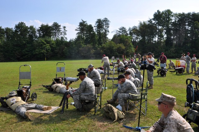 MARINE CORPS BASE QUANTICO -- Soldiers, Marines, Airmen and Sailors fire on their targets during the 10-man Intereservice team championship match July 27. The Soldiers from the U.S. Army Marksmanship Unit won the match and swept every major award at the 49th Interservice Rifle Championships, giving the Army victories at every Interservice marksmanship competition in 2010. (Photo by Michael Molinaro, USAMU PAO)