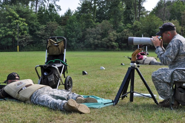MARINE CORPS BASE QUANTICO -- Staff Sgt. Brandon Green, U.S. Army Marksmanship Unit, fires on a target July 27th during the Interservice Rifle Championships. Green won the overall individual championship and the USAMU Service Rifle team swept every team match on their way to the championship. Sgt. 1st Class Emil Praslick looks on as the coach of the 10-man team. (Photo by Michael Molinaro, USAMU PAO)