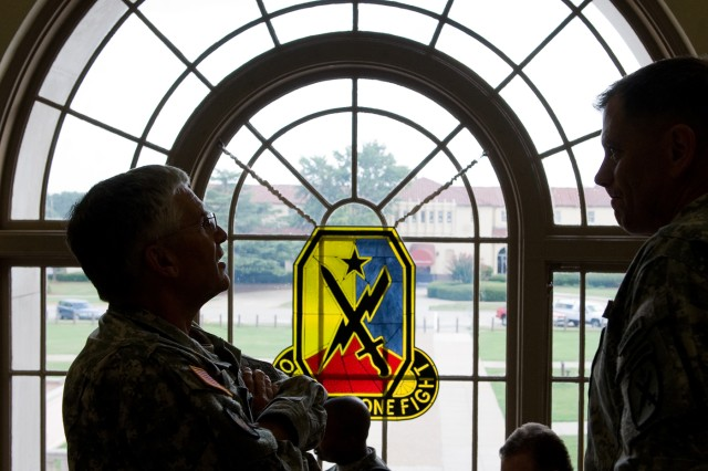 Chief of Staff of the Army Gen. George W. Casey Jr. and Maj. Gen. Mike Ferriter observe the portraits of past commanders of the Maneuvers Centers of Excellence at Fort Benning, Ga., Aug. 2, 2010.