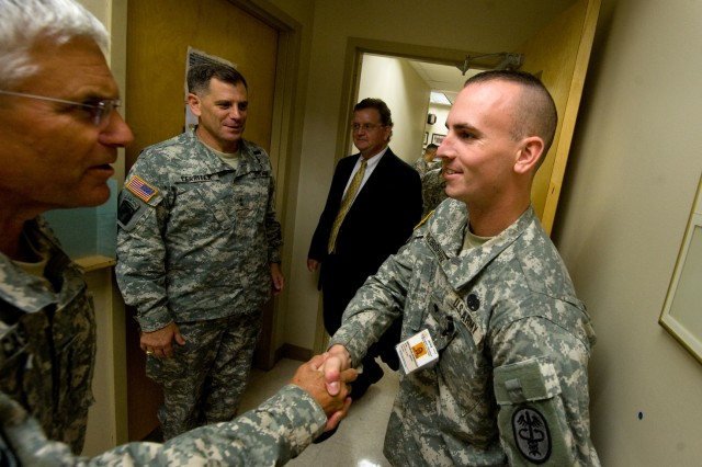 Chief of Staff of the Army Gen. George W. Casey Jr. talks with Spc. Kevin Robinson, a medic, during a tour of the Martin Army Community Hospital at Fort Benning, Ga., Aug. 2, 2010.