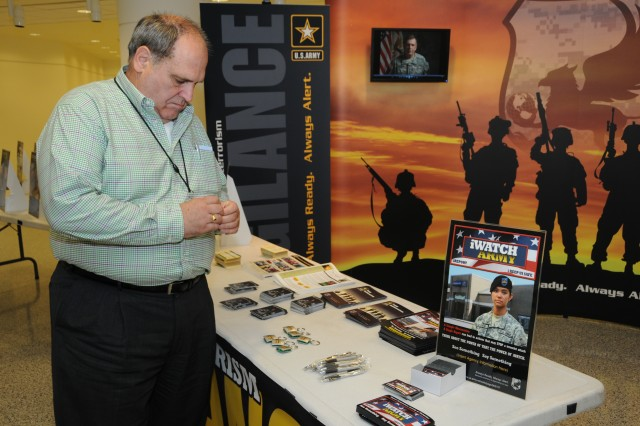 A Pentagon employee looks over the Anti-Terrorism Awareness Month display there August 2. The Army is observing AT Awareness Month in 2010 for the first time.