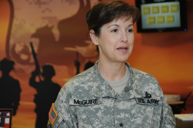 Brig. Gen. Colleen L. McGuire, provost marshal general of the Army, speaks at the Pentagon August 2 about the Army's Anti-Terrorism Awareness Month now being held in August of each year. Part of AT Awareness Month is a push for the use of iWatch -- a community program which encourages vigilance and proper reporting to base authorities of suspicious activity.