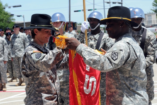 Lt. Col. Paula Lodi, commander, and Master Sgt. Donald Hutchinson, rear detachment senior noncommissioned officer, 15th Special Troops Battalion, 15th Sustainment Brigade, 13th Sustainment Command (Expeditionary) uncases the Wranglers' colors during a small ceremony here July 16.