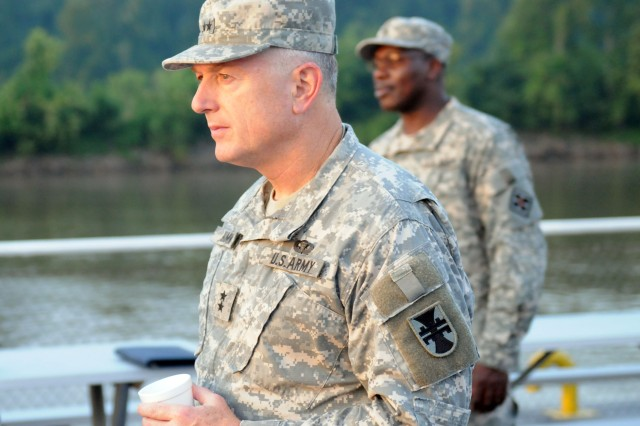 "Maj. Gen. Paul Hamm, Commanding General; 412th Theater Engineer Command, observes from a river barge as engineers from the 416th and 412th Theater Engineer Commands bridge the Arkansas as part of operation ""River Assault"" on July 21, 2010."