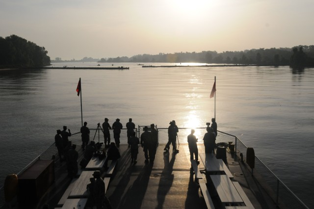 "Guests and media observe from a river barge as engineers from the 416th and 412th Theater Engineer Commands bridged the Arkansas as part of operation ""River Assault"" on July 21, 2010."
