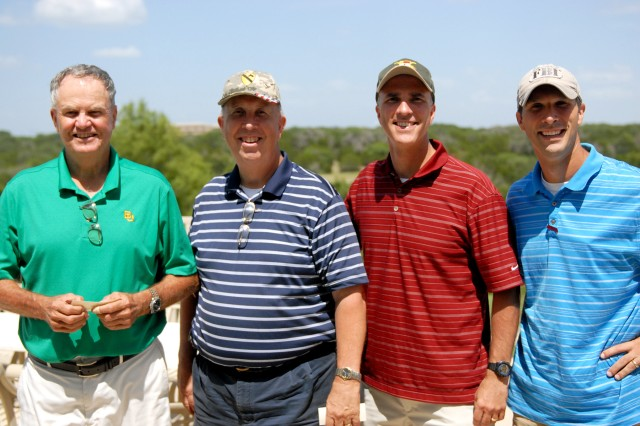 FORT HOOD, Texas-The team of (from left to right) Dr. Dick Couey, Nathan Cook, Lt. Col. Nate Cook, commander, 3rd Battalion, 82nd Field Artillery Regiment, 2nd Brigade Combat Team, 1st Cavalry Division, and Danny Cook, won the tournament with a posted score of 58 during the Red Team's United States Field Artillery Association golf tournament, here, July 29.