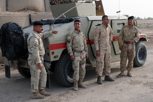 BAGHDAD - Sixth Iraqi Army Division Soldiers stand by their Humvees in preparation for an improvised explosive device detection and reaction class taught by 501st Military Police Company, Division Special Troops Battalion, 1st Armored Div., at Contingency Operating Location Constitution July 26.   (U.S. Army photo by Sgt. Phillip Valentine, 366th MPAD, USD-C)