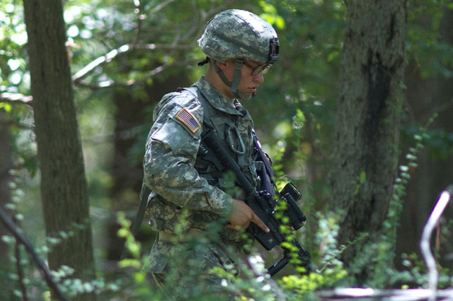 A new cadet assigned to Alpha Company moves through the woods during live-fire lane training July 26.
