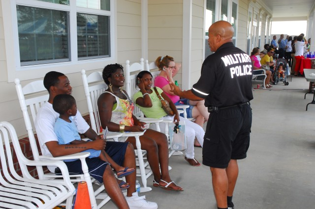 Fort Jackson Police Officer Lionel Brown speaks to National Night Out attendees in front of the Community Center.