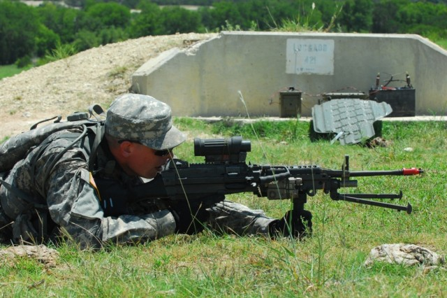 FORT HOOD, Texas- Pvt. Dane Weatherstine, from Baltimore, an infantryman with 2nd Brigade Combat Team, 1st Cavalry Division, looks through the scope of his squad automatic weapon during rehearsal for live-fire team training, Aug. 3.