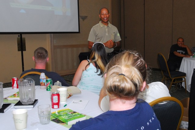 San Antonio, Texas-Chaplain (Maj.) Joshua Pair, 2nd Brigade Combat Team, 1st Cavalry Division, talks to married couples about how to deal with conflicts and stresses that arise during marriage during a retreat, July 29.