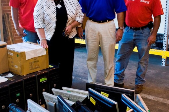 From left: Mike Ward with Calhoun County Schools; Jeni Cline of DCFA; Joe Dyar, principal of WPMS; and Danny Baldwin of Calhoun County Schools look over the computers being donated by Anniston Army Depot.