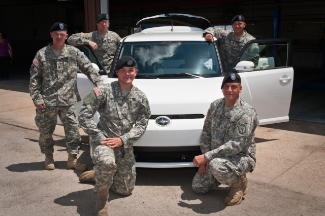 """Five Soldiers from the 4th Maneuver Enhancement Brigade at Fort Leonard Wood will represent the U.S. Army during the final stage of Scion's """"Battle of the Builds,"""" a unique car customization challenge for teams of active duty military.       Toyota-Scion presented Team """"Sapper,"""" which consists of Pfc. Joseph Schnieder, Pfc. Daniel Ward, Pfc. Nathaniel Machoski, Spc. Dustin Ward, and Spc. Harold Yeo with a 2011 Scion xB and $15,000 to make their """"rest and relaxation"""" concept a reality.       Teams will have until Oct. 5 to transform their conceptual sketches into reality, and one team will be selected Oct. 18 as the winner. The winning team will be invited to the 2010 Specialty Equipment Market Association show in Las Vegas, Nev., to showcase their modified Scion xB."""