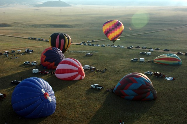 FORT CARSON, Colo.- Hot air balloons lift off during the Celebration of Honor Fly July 24.