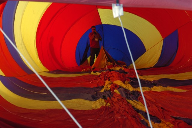 "FORT CARSON, Colo.- Chuck Danley, pilot of ""Great Escape,"" prepares his hot air balloon for flight during the Celebration of Honor Fly July 24. Danley, a retired U.S. Air Force major, said he began ballooning in 2008 and loves showing new people his sport."