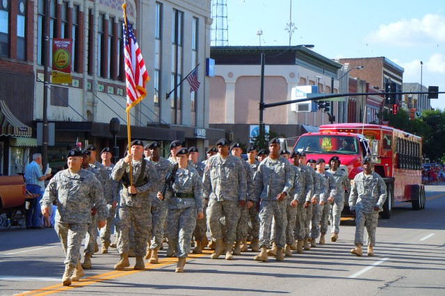 Members of the Combat Aviation Brigade, 1st Infantry Division, march in the Saline County Tri-River parade Aug. 4 in downtown Salina. The Soldiers were in Salina participating in a signing of the Army Community Covenant. The Covenant re-affirms the commitment between Fort Riley and Saline County to support and sustain each other's communities.