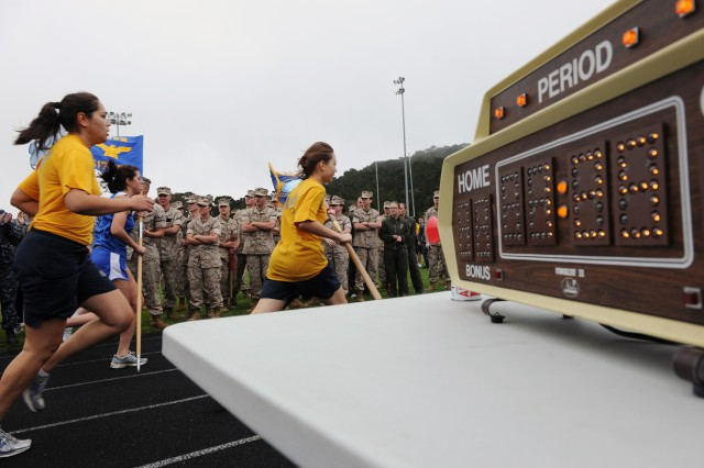 PRESIDIO OF MONTEREY, Calif. - Presidio of Monterey female service members race for the fastest time during the Commander's Cup here Aug. 4. The Army running team took back the cup after suffering a loss from the Air Force last quarter.