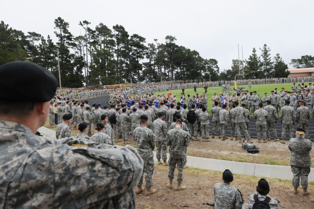 PRESIDIO OF MONTEREY, Calif. - Soldiers take advantageous observation points to watch the joint-service race for the Commander's Cup here Aug. 4.