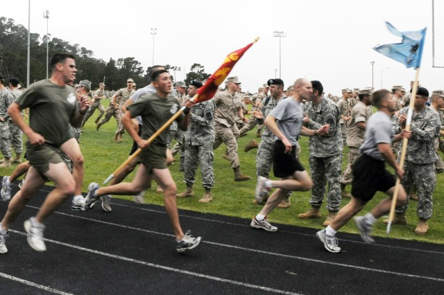 PRESIDIO OF MONTEREY, Calif. - Presidio of Monterey Marines and Soldiers run with their respective teams when it seemed the Marine team would pass the Army team. The teams ended their run with a tie that was decided by a one-on-one race.