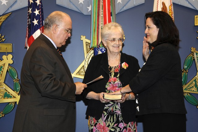New assistant secretary takes oath