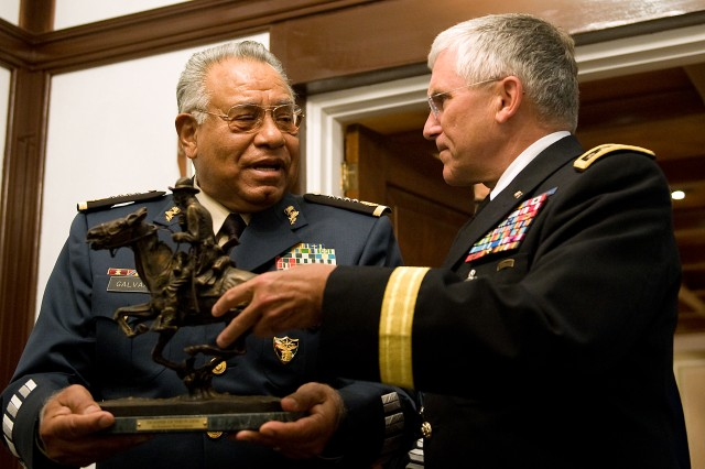 Chief of Staff of the Army, Gen. George W. Casey Jr., gives Gen. Guillermo Galvan, Secretary of Mexico's National Defense, a Remington Statue as part of a gift exchange and at the conclusion of their meeting in Mexico City, Mexico, Aug. 4, 2010.