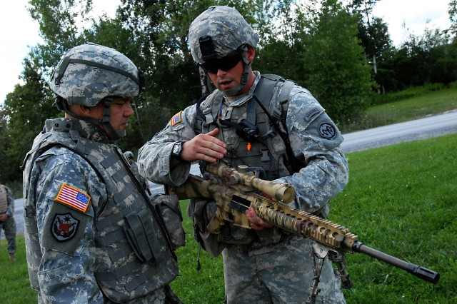42nd Division Commander Examine Sniper Rifle