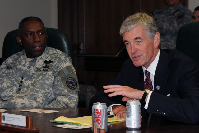 """Army Secretary John McHugh meets with Gen. William """"Kip"""" Ward, commander, U.S. Africa Command, during a mission overview briefing, Tuesday, July 27, 2010 at Kelley Barracks, Stuttgart, Germany.  U.S. Army photo by Staff Sgt. Matthew Clifton."""