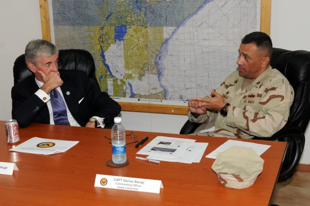 Army Secretary John McHugh, left, meets with Navy Capt. Darius Banaji, camp commander, during a mission overview brief, Friday, 30 July, 2010, at Camp Lemonnier, Djibouti, Africa.  U.S. Army photo by Staff Sgt. Matthew Clifton.
