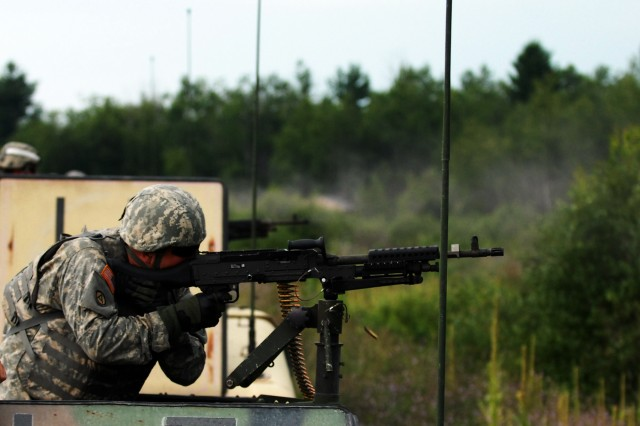 FORT DRUM, NY--Rochester resident Spc. Timothy Marciniak, a driver with A Company, 427th Brigade Support Battalion, fires an M-240B machine gun from the turret of his crew's Humvee Wednesday, July 28. The 427th BSB was conducting exercises on Fort Drum as part of the 27th Infantry Brigade Combat Team's annual training.