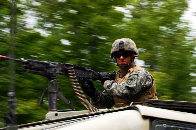 FORT DRUM, NY--Spc. Michael Beane, a B Company mechanic from Sodus, N.Y., mans an M-240B machine gun from a Humvee's gunner turret during the 427th Brigade Support Battalion's convoy training on Fort Drum July 28.