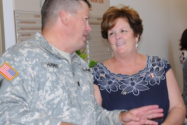 Debbie Barclay says goodbye to Lt. Col. Michael Hughes, Fort Rucker emergency operations officer, during her farewell luncheon Aug. 2 in the headquarters building. Barclay and her husband, Maj. Gen. James O. Barclay III, USAACE and Fort Rucker commanding general, move to serve at the Pentagon after two years here.