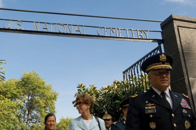 Chief of Staff of the Army, Gen. George W. Casey Jr., and his wife, Sheila, complete their visit to the US National Cemetery in Mexico City, Mexico, Aug. 4, 2010.   The cemetery was established in 1851 and contains the remains of 1563 American Soldiers from the War of 1847.