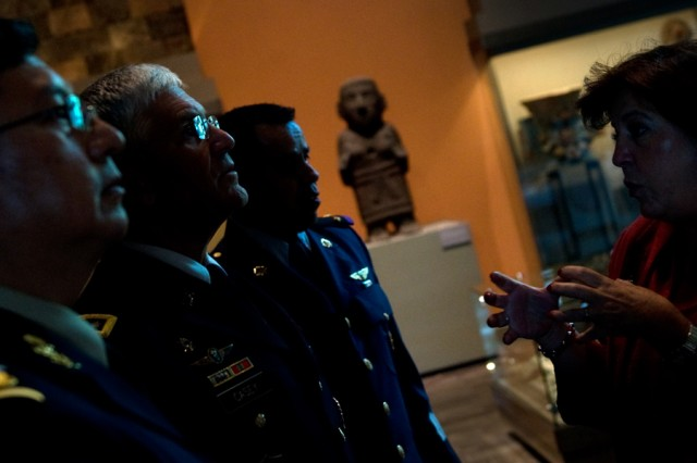 A curator from the Mexican National Museum of Anthropology tells the Chief of Staff of the Army, Gen. George W. Casey Jr., about the museum's displays in Mexico City, Mexico, Aug. 4, 2010.
