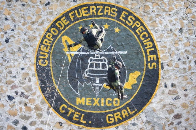 Mexican Special Forces give a fast-rope demonstration during a visit from Gen. George W. Casey Jr., at a military camp outside Mexico City, Mexico, Aug. 4, 2010.
