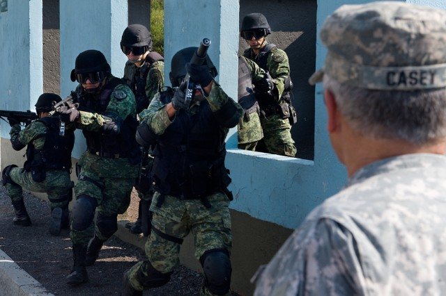 Mexican Special Forces give a breaching demonstration to Gen. George W. Casey Jr., at a military camp outside Mexico City, Mexico, Aug. 4, 2010.