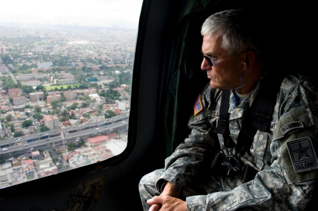 Chief of Staff of the Army, Gen. George W. Casey Jr., looks over Mexico City, Mexico, while flying in a helicopter and in-between events on Aug. 4, 2010.