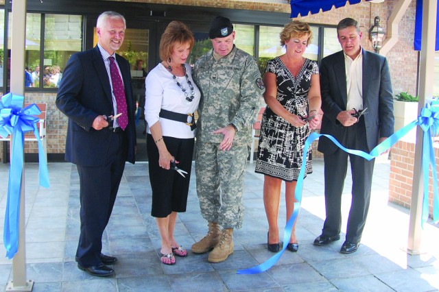 From left, Bob Chitty, senior vice president corporate investment, InterContinental Hotel Group; Kathy Yarbrough, spouse of Joint Readiness Training Center and Fort Polk commander Brig. Gen. James Yarbrough; Col. Francis Burns, Fort Polk garrison commander; Rhonda Hayes, chief, Capital Ventures Directorate, Office of the Deputy Assistant Secretary of the Army (Installations and Housing); and Charles Parker, executive general manager for development, public private partnerships, Actus Lend Lease, cut the ribbon marking the official opening of the first branded Holiday Inn Express on a U.S. Army installation.