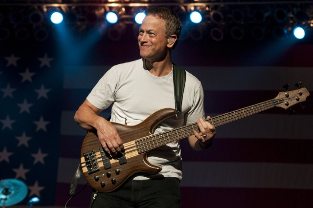 Gary Sinise plays his guitar during a performance at the Crown Coliseum in Fayetteville, July 31. The Lt. Dan Band performed a free concert for military servicemembers and their Families.