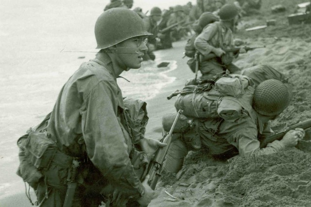 Onto the Beach: American Soldiers moving ashore at Aitape, New Guinea, 22 April 1944. (World War II Signal Corps Collection)