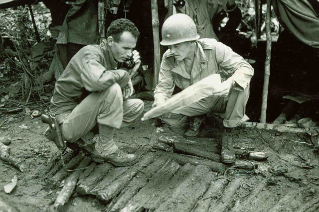 Command Decisions: Lieutenant Colonel P.L. Hooper and Brigadier General Julian Cunningham examining a map at a command post near the Driniumor River, New Guinea, August 9, 1944.( WWII Signal Corps Collection)