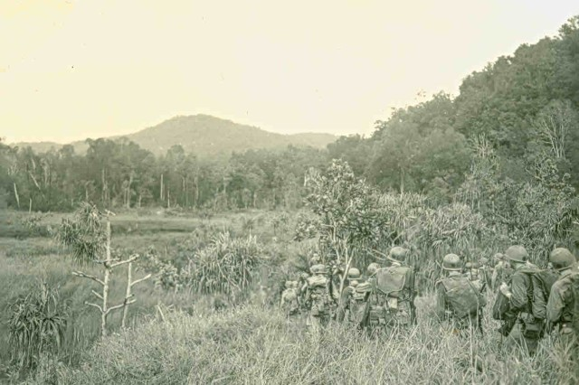 From the Beach to the Bush! American Soldiers moving east from the beach head at Aitape into the jungle and towards the Driniumor River, New Guinea, May 1944. (WWII Signal Corps Collection).