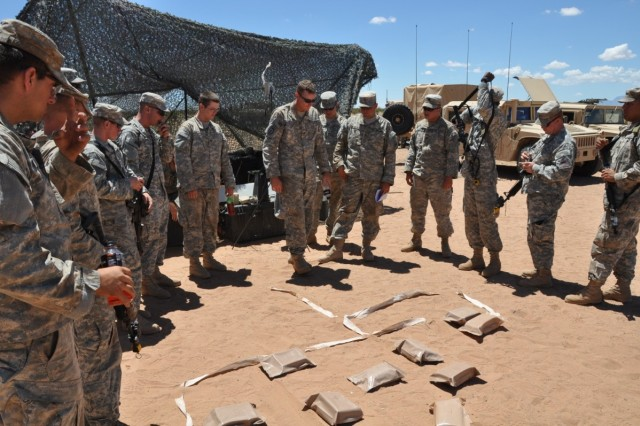 Soldiers from Delta Company work over the assault plan on an objective.